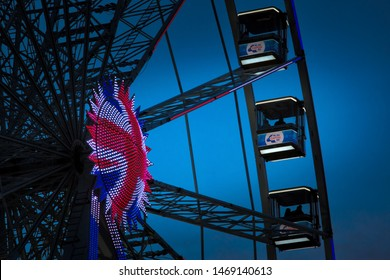Nottingham, England, UK. February 17, 2019 Nottingham observation wheel lit up in front of a clear blue sky. Located in Nottingham Old Market Square