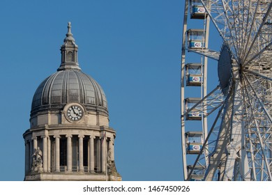 Nottingham, England, UK. February 23, 2019 Nottingham council house building. The city hall of Nottingham & observation wheel side by side in Old Market Square in Nottingham city centre.