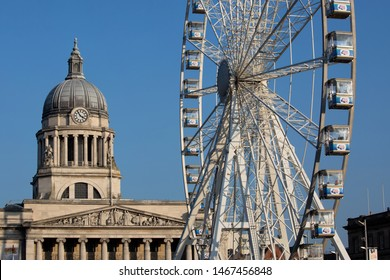 Nottingham, England, UK. February 23, 2019 Nottingham council house building. The city hall of Nottingham located in Old Market Square in Nottingham city centre. Side by side with observation wheel