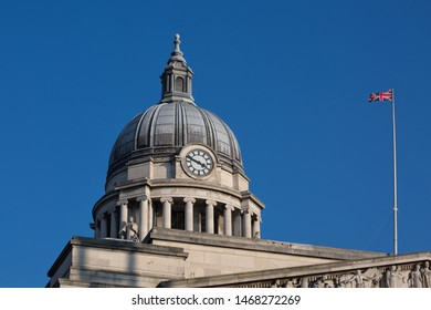 Nottingham, England, UK. February 23, 2019 Nottingham council house clock with Union Jack flag at full mast. The city hall of Nottingham located in Old Market Square in Nottingham city centre.