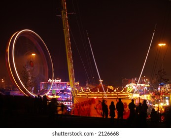 Nottingham Guy Fawkes Fairground. Silhouettes against circus lights.