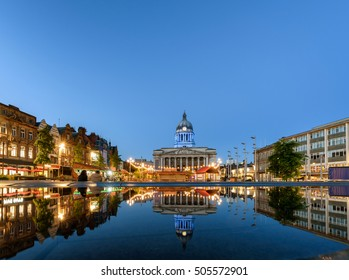 Nottingham market square with council house and new redevelopment pool with fountain in the square in Nottingham city, England.