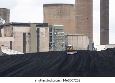 Nottingham, Nottinghamshire, England, United Kingdom. August 18, 2018. Plant machinery working on coal stack at Ratcliffe-on-Soar coal-fired power station in Nottinghamshire, England, UK
