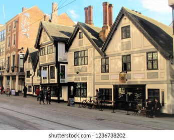 Nottingham, Nottinghamshire, UK. February 11, 2016. People walking  outside the Grade two listed former public house established around 1483 and now a shopping mall at Nottingham in Nottinghamshire.