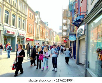 Nottingham, Nottinghamshire, UK. March 24, 2011. Locals tourists and shoppers walking and browsing the shops on Clumber street at Nottingham in Nottinghamshire, UK.
