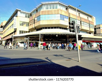 Nottingham, Nottinghamshire, UK. March 24, 2011.  Shoppers walking into the entrance of the popular Victoria shopping centre at Nottingham in Nottinghamshire, UK.