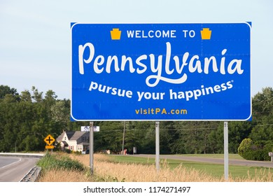NOTTINGHAM, PA / USA - JUNE 29, 2018:  Road sign located along Route 1 North welcomes drivers to the Commonwealth of Pennsylvania, also known as the Keystone State.