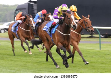 NOTTINGHAM RACECOURSE, COLWICK PARK, NOTTS, UK : 30 APRIL 2019 : Racehorse Daddies Girl ridden by jockey Theodore Ladd Winning the 1m Fillies Handicap at Nottingham Races