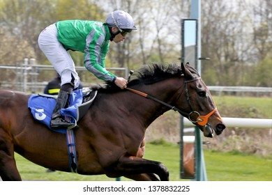NOTTINGHAM RACECOURSE, COLWICK PARK, NOTTINGHAM, UK : 10 APRIL 2019 : Racehorse King Of Change ridden by Sean Levey goes past the Winning Post and wins the 3yo Novice Stakes at Nottingham Races