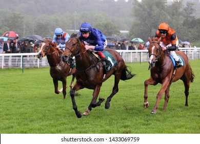 NOTTINGHAM RACECOURSE, NOTTINGHAM, UK : 13 JUNE 2019 : The Godolphin owned Big City ridden by Adam Kirby winning the 6f 2yo Novice Stakes in wet conditions at Nottingham Races