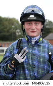 NOTTINGHAM RACECOURSE, NOTTINGHAM, UK : 16 JULY 2019 : Young jockey Cieren Fallon celebrates and signals riding a winning hat trick and treble with his fingers at Nottingham Races