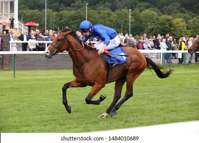 NOTTINGHAM RACECOURSE, NOTTINGHAM, UK : 19 JULY 2019 : The Godolphin owned Visible Charm ridden by Adam Kirby winning the 6f Maiden Stakes at Nottingham Races