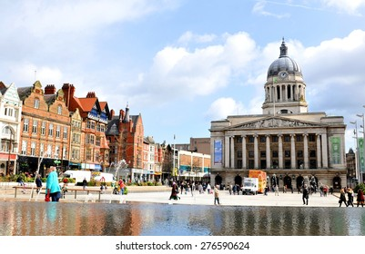 NOTTINGHAM, UK - APRIL 1, 2015: The iconic building of the Nottingham Council House overlooks the populated Old Market Square, major landmark of Nottingham, Nottinghamshire in East Midlands, England