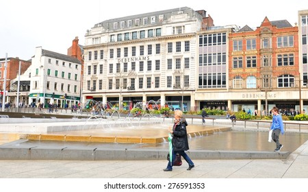 NOTTINGHAM, UK - APRIL 1, 2015: Pedestrians pass by Debenhams shop in the Old Market Square of Nottingham. Debenhams is a famous store chain selling own-brand and international fashion products.
