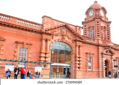 NOTTINGHAM, UK - APRIL 1, 2015: People wait outside the recently inaugurated train station in Nottingham, Nottinghamshire, East Midlands, England.