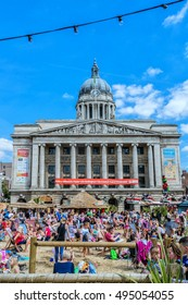 NOTTINGHAM, UK - AUGUST 13, 2016: Council House (City Hall) at Old Market Square with a pool, fountain, sand and beach chairs in the foreground.