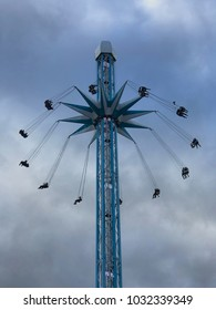 NOTTINGHAM, UK - February 17 2018: Starflyer Nottingham, people on a ride going up to the top of the ride on an overcast day.