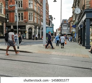 NOTTINGHAM, UK -  JULY 15, 2019:  View of a shoppers walking across the tram lines on Victoria Street, Nottingham, Nottinghamshire, England, UK,