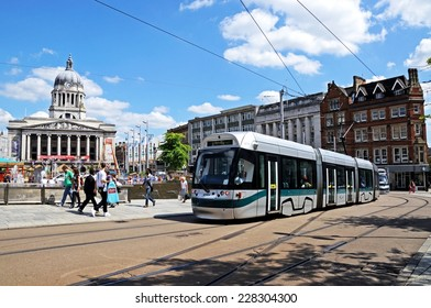NOTTINGHAM, UK - JULY 17, 2014 - Modern tram passing the Council House also known as the city hall in the Old Market Square, Nottingham, Nottinghamshire, England, UK, Western Europe, July 17, 2014.