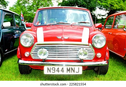 NOTTINGHAM, UK. JUNE 1, 2014: Frontal view of a red Mini Cooper vintage car for sale in Nottingham, England.