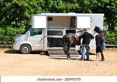 Nottingham, UK - June 7, 2015: Farmers prepare horses by special transportation van prior to the Sunday Farm Day in Nottingham, Nottinghamshire, England.