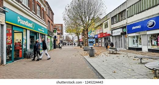 NOTTINGHAM, UK - NOVEMBER 25, 2018: Shoppers walking along Beeston high street on a cool November day