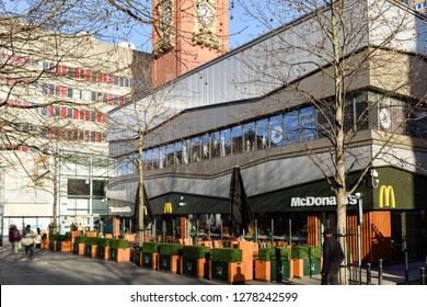 Nottingham,England,UK. January 08th 2019. Unusual mild temperatures for Winter in the UK,People enjoy eating outside a city centre McDonald's  on Milton street in Nottingham.
