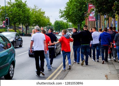Nottingham,UK. September 14th 2014. Championship football match between fierce rivals Nottingham Forest and Derby County.Forest fans daunt rams supporters of their way to the city ground.