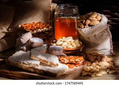 nougat on wooden board, sweets prepared with honey almond, the candy caramel turron is typical of Alicante Spain turron