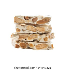Nougat Turron Crunchy Almond Isolated on White Background. Selective focus.