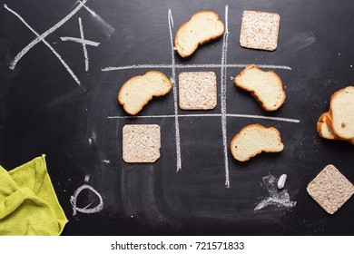 Noughts and Crosses Choice Competition Game Between Useful Low-Calorie Product Small Loaf and Harmful Calories White Bread Food Diet Creative Concept Black Background