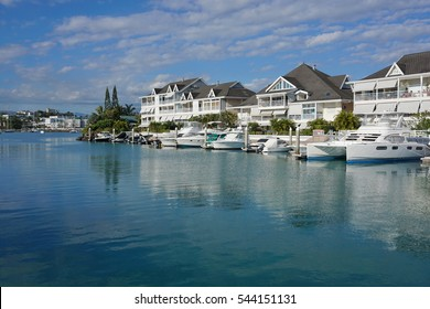 Noumea city, boats moored in a marina with residences, Orphelinat bay, Grande Terre island, New Caledonia, south Pacific