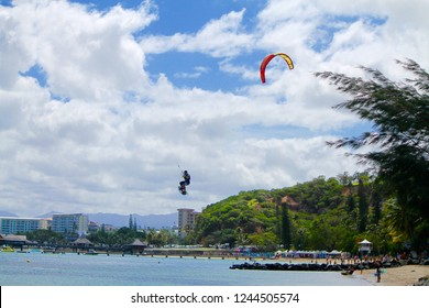 Noumea New Caledonia France april 5 2015 Kite surfer flying above a beach of Noumea in New Caledonia