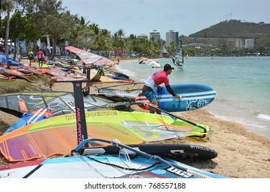 Noumea, New Caledonia - November 25, 2017: Competitors and sail boards on the beach at the 2017 Noumea Dream Cup Windsurfing championship.