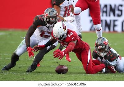 Nov 10, 2019; Tampa, FL USA;  After Tampa Bay Buccaneers running back Ronald Jones (27) fumbles the ball, Arizona Cardinals strong safety Budda Baker (32) recovers it.