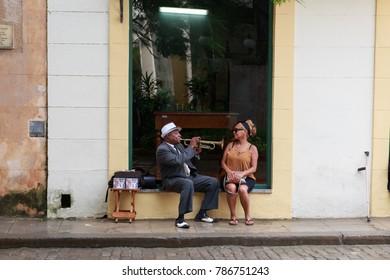 NOV. 12 2017 - HAVANA, CUBA - A man plays trumpet for a tourist in old Havana, Cuba.