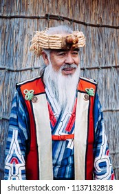 NOV 20, 2013 Hokkaido, JAPAN - A man in Ainu tradition tribal costume at Shiraoi Ainu Museum. The indigenous people of northern Japan.