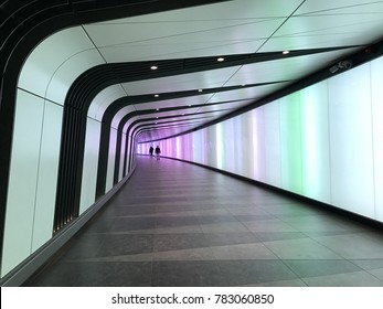 NOV 2017 - LONDON, UK - The King's Cross tunnel with LED light wall curving along underground walk way between King's Cross and St.Pancras station in City of London.