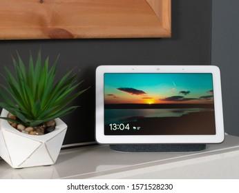 Nov 2019, UK - Google Nest Hub in home setting - Digital Photo frame decor on show with time