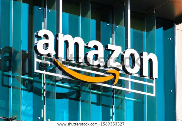 Nov 22, 2019 Palo Alto / CA / USA - Close up of Amazon logo and Smile symbol at one of their corporate offices located in Silicon Valley, San Francisco bay area