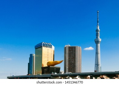 NOV 29, 2018 Tokyo, Japan - Tokyo Skytree Tower rised high against blue sky with Asahi Beer Hall in winter shot from Asakusa area, Japan famous modern landmark and cityscape