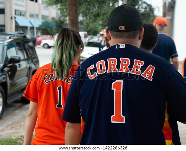 NOV 3rd 2017. Houston, Texas, United States of America: Two Astros fans marching to the World Series TItle celebration, with Correa shirts, in Downtown Houstown