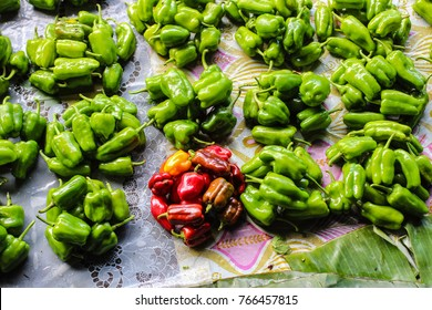 Nov2017, Central market, Honiara, Solomon Islands, neat heaps of green and red peppers are piled up for sale in the main market