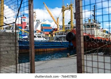 Nov2017, Point Cruz, Honiara, Solomon Islands, looking through the gate at the jetty towards the inter island ships