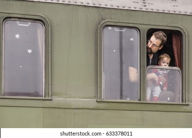 Nova Gorica, Slovenia - December 6, 2015: Father and Son are looking from window of passanger Wagon of old steam train.
