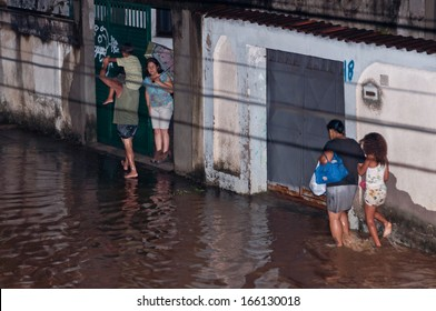 NOVA IGUACU, RIO DE JANEIRO, BRAZIL - DECEMBER 6: Poor living area flooded after heavy rain on 6th December, 2013. The water level of local river got few meters higher, many houses were flooded.