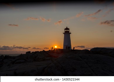 Nova Scotia,Canada,11,2017:Peggy,s cove lighthouse at sunset and at night