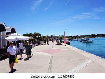Novalja, Croatia, Jun 23, 2018. Waterfront in Novalja, popular touristic destination for young people in Croatian Island of Pag