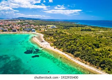 Novalja, Pag island. Idyllic beach and turquoise sea aerial view in town of Novalja, Adriatic archipelago of Croatia