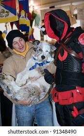 "NOVARA, ITALY - DECEMBER 18: Hero in costume meets his fan in  ""Be A Superhero Contest"" on December 18, 2011 in Novara, Italy"